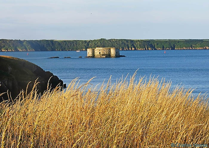 View of the fort on Stack Rock in Milford Haven, Pembrokeshire photographed from The Wales Coast Path by Charles Hawes