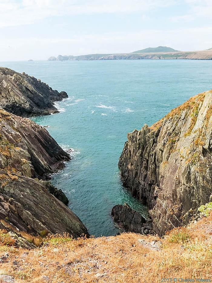 Deep inlet near St Justinian's Pembrokeshire with view to Ramsey Island, photographed from The wales Coast Path by Charles Hawes