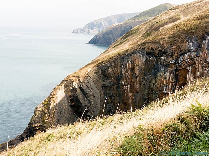 Pen-Yr-Afr, Pembrokeshire, in the distance, photographed from The Wales Coast path by Charles Hawes