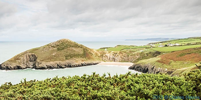 View of Foel y Mwnt and the beach and chapel looking north, photographed from The Wales Coast Path by Charles Hawes