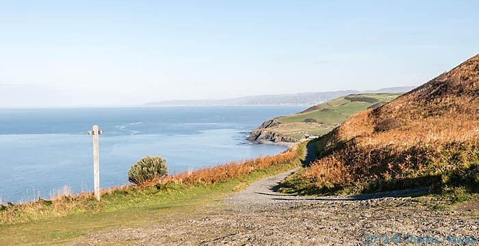 Finger post for the Ceredigion Coast Path on Constitution Hall, Aberystwyth, photographed by Charles Hawes
