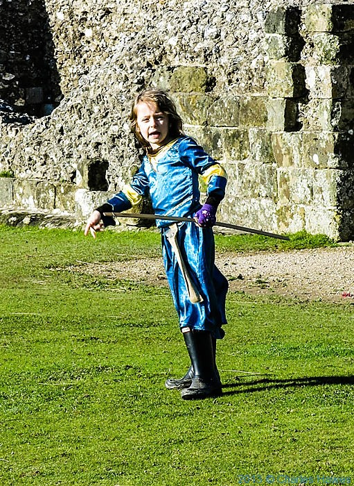 Child playing with bow and arrows in Old Sarum, Wiltshire, photographed by Charles Hawes
