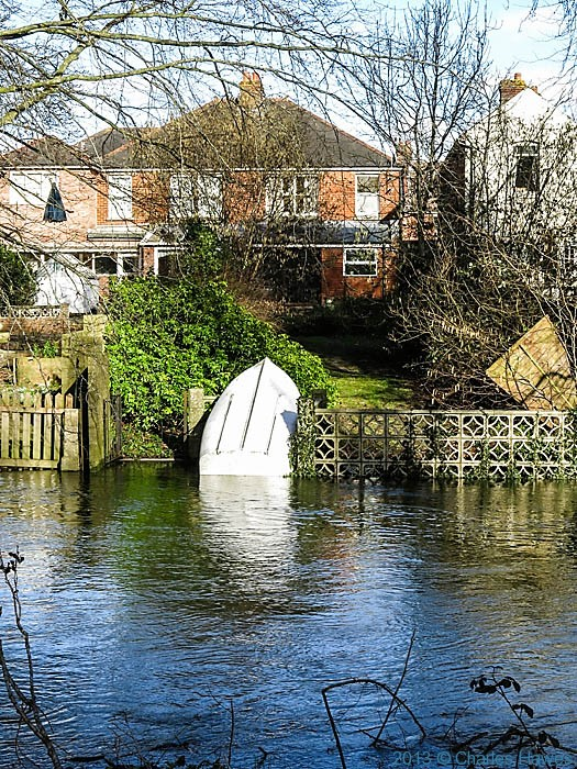 River Avon encroaching on bottom of garden in Salisbury, Wiltshire, photographed by Charles Hawes