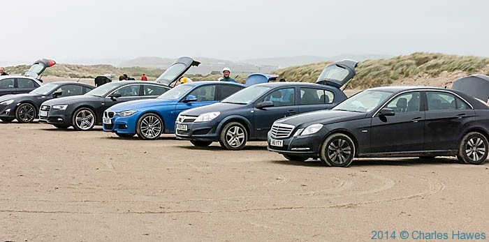 Cars parked on Black Rock Sands, Lleyn peninsula, photographed from The Wales Coast Path by Charles Hawes