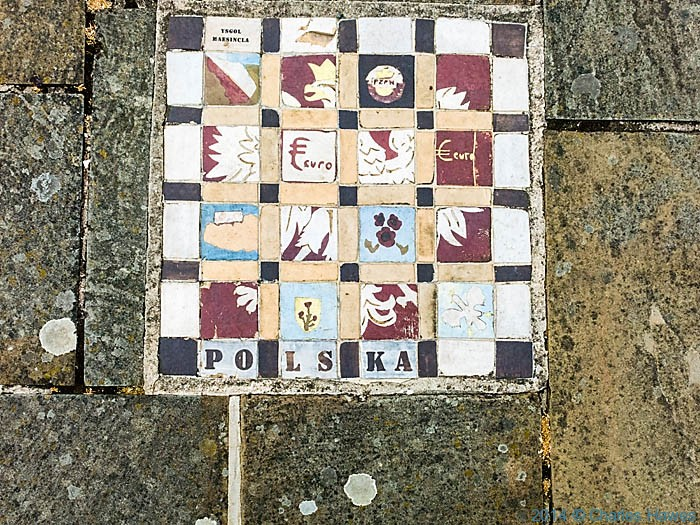 Ceramic tiles in Caernarfon marina, photographed from The Wales Coast Path by Charles Hawes