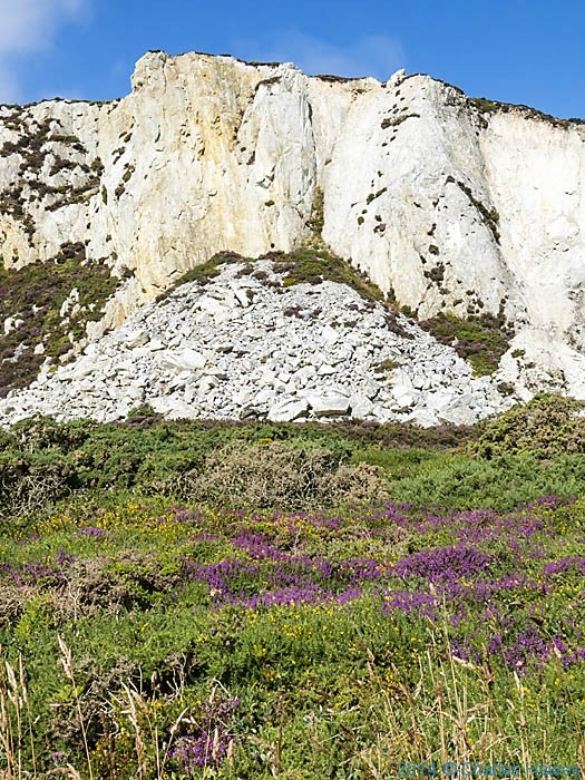 Cliffs on the edge of Holyhead Mountain, Anglesey, photographed from The Wales Coast Path by Charles Hawes