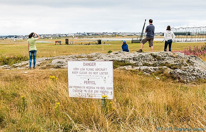 Spectators at RAF Valley on Anglesey, photographed from The Wales Coast Path by Charles Hawes