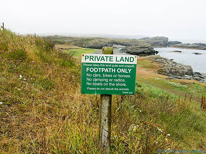 Sign near Lee Caravan Park, Anglesey, photographed from The Wales Coast Path by Charles Hawes