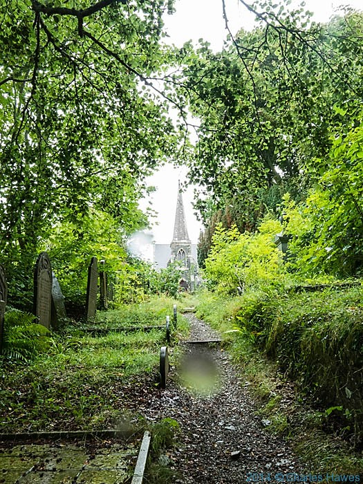St Marys Church near Llanfair PG, photographed from the Wales Coast Path on Anglesey by Charles Hawes