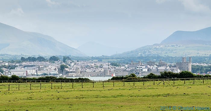View to Caernarfon across the Menai Strait, photographed from The Wales Coast path by Charles Hawes