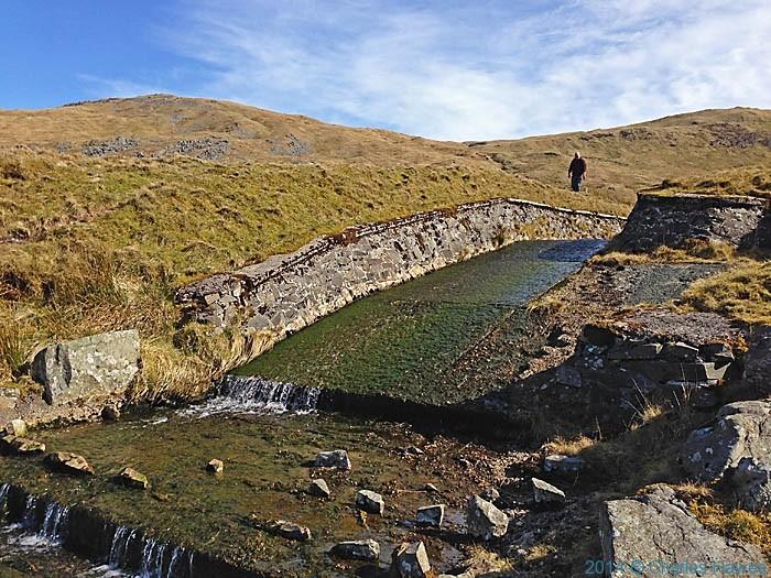 Nant y Llyn, flowing out of the Llyn Llgad Rheidol Reservoir near Plynlimon, photographed by Charles Hawes