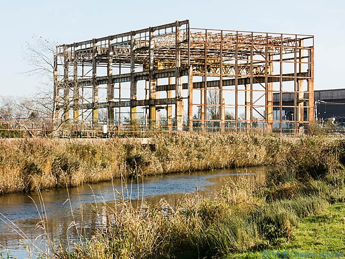 Rusted steel structure on the banks of the River Stour, photographed from The Saxon Shore way by Charles Hawes