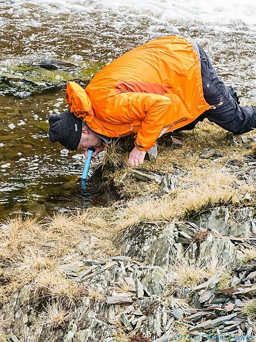 Charles Hawes using the Lifestraw in the Afon Clywedog