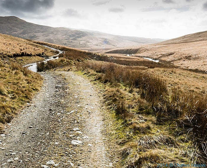 Track leading from Nant y moch reservoir, Powys, photographed by Charles Hawes