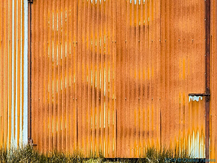 Rusted corrugated Iron sides of farm building at Bugeilyn photographed by Charles Hawes