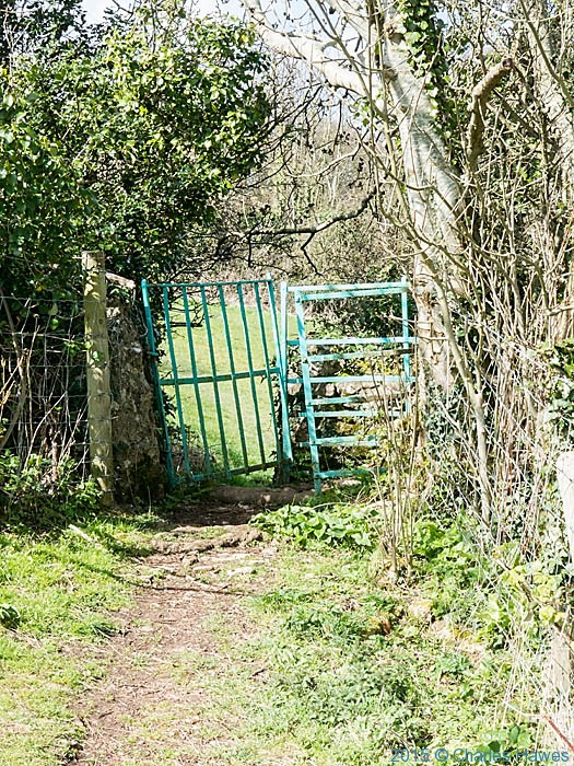 Turquoise painted gate near Caim, Anglesey, photographed on The Wales Coast Path by Charles Hawes