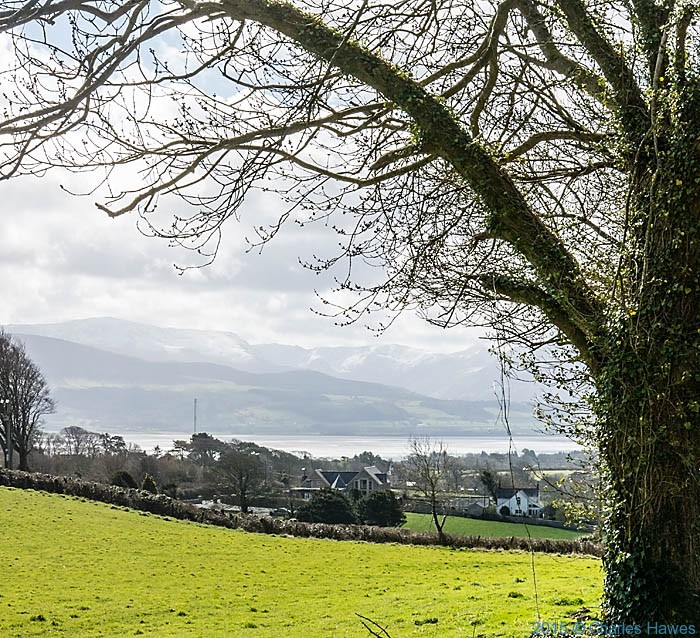 View to Snowdonia across the Menai Strait photographed from near Glan yr Afon, Anglseey from the Wales Coast Path by Charles Hawes