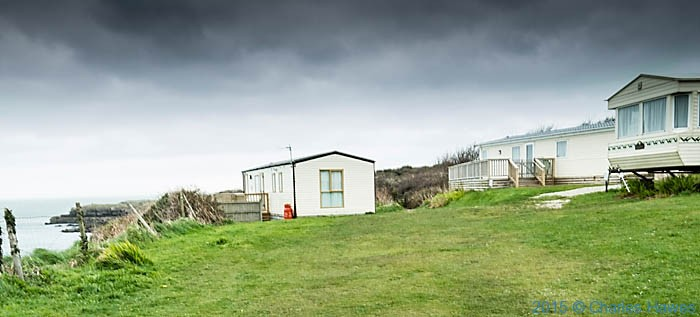 Caravan site near Treath Lligwy, phootgraphed from The Wales Coast Path in Anglesey by Charles Hawes