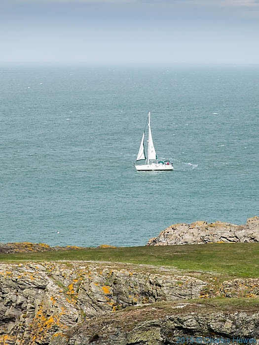 Yacht off Carmel Head, Anglesey, Photographed from The Wales Coast Path by Charles Hawes
