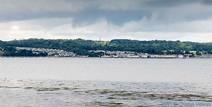 View to Beaumaris from across the Lavan sands. photographed from The Wales Coast Path by Charles Hawes