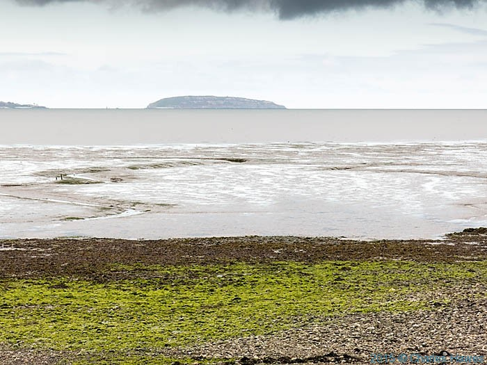 View to Puffin Island across the Lavan sands, photographed from The Wales Coast Path by Charles Hawes