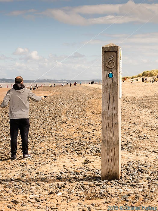 Wales Coast Path way-mark on Point of Ayr beach, photographed by Charles Hawes