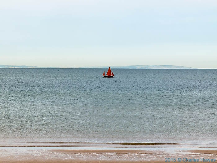 Sailing boat off Conwy Sands, photographed from The Wales Coast Path by Charles Hawes