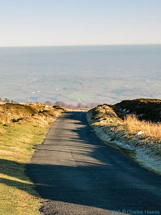 Mountain road by the twin masts of WT station at Cefn y Galchen, photographed from The Cambrian Way by Charles Hawes