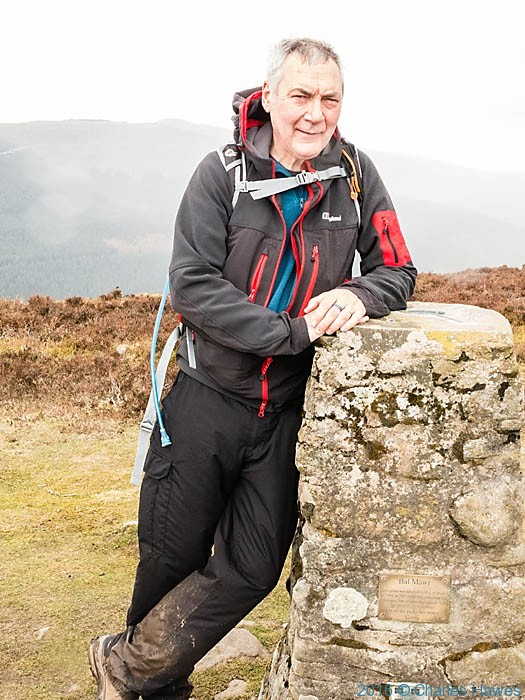 Charles Hawes at Bel Mawr Trig Point on the Cambrian Way, photographed by Charles Hawes