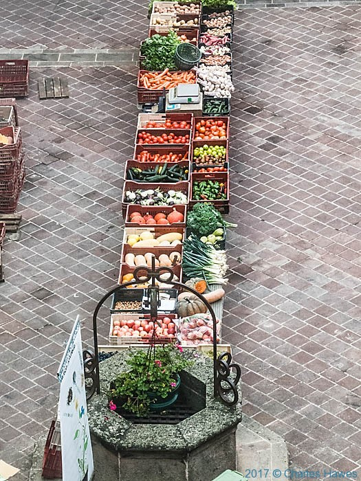 Market in Caselnau de Montmiral, France, photographed by Charles Hawes