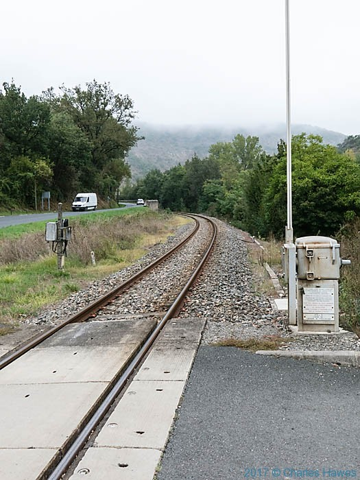 Railway line and D600 at Marnaves, France, photographed by Charles Hawes