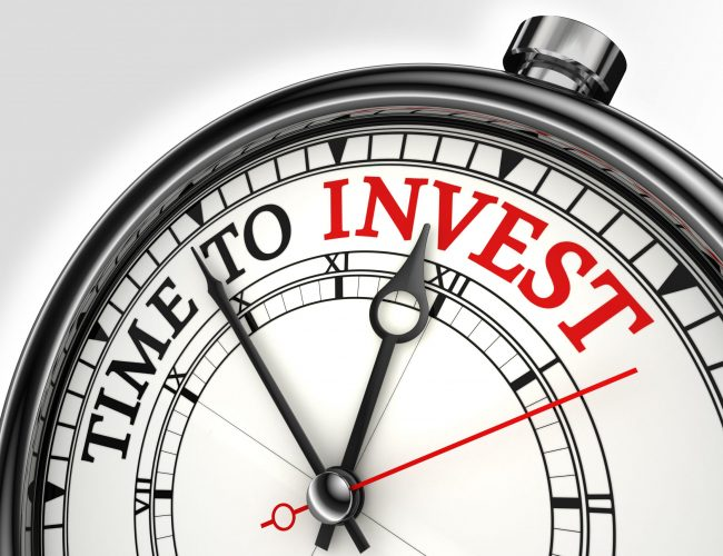 time to invest concept clock