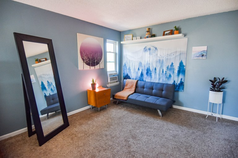 new home bedroom with couch and blue walls
