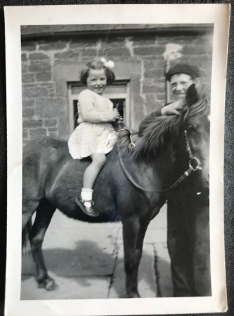 old picture of mum on a pony
