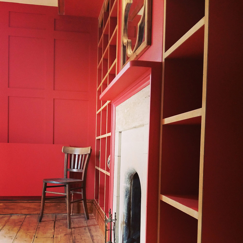charlie-caffyn-designs-painted-bookcase-with-ash-lips