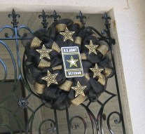 Wreath hanging on the gate of the crypt