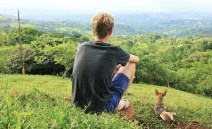 Luke sitting on the hill with Ridgie