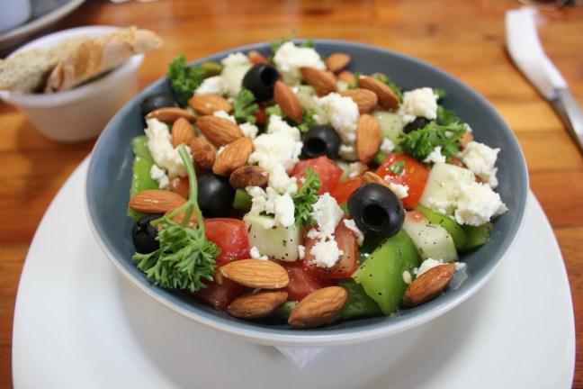 Eating Greek Salad at Cafe in Granada - Charlie on Travel