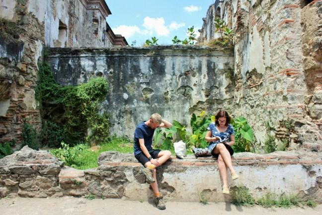 Luke and Julia on wall in Antigua Guatemala - Charlie on Travel