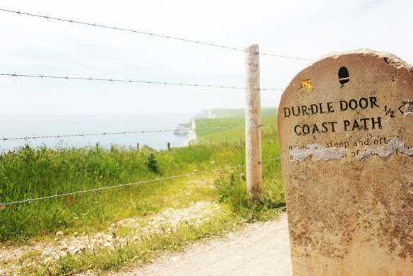 Lulworth Cove England Durdledoor sign - Charlie on Travel
