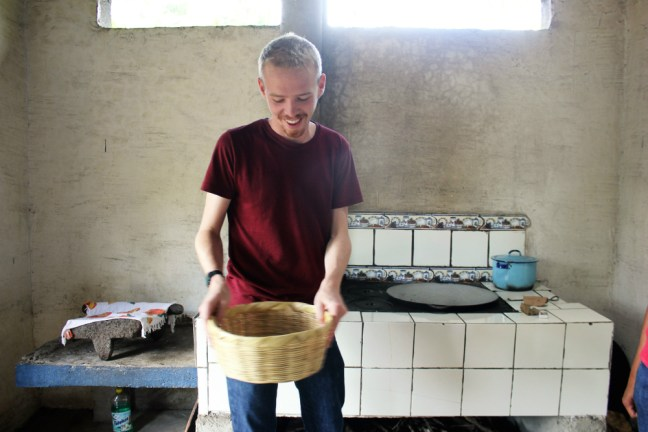 peanut-butter-workshop-with-de-la-gente-antigua-guatemala-charlie-on-travel-luke-shaking-peanuts