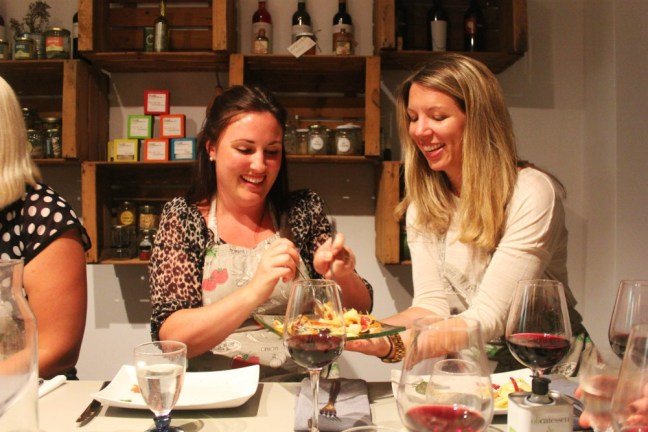 Sharing food at Barcelona Slow Travel tapas cooking class - Charlie on Travel