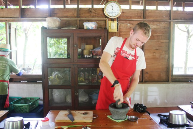 Luke cooking at Thai Farm Cooking Class in Chiang Mai