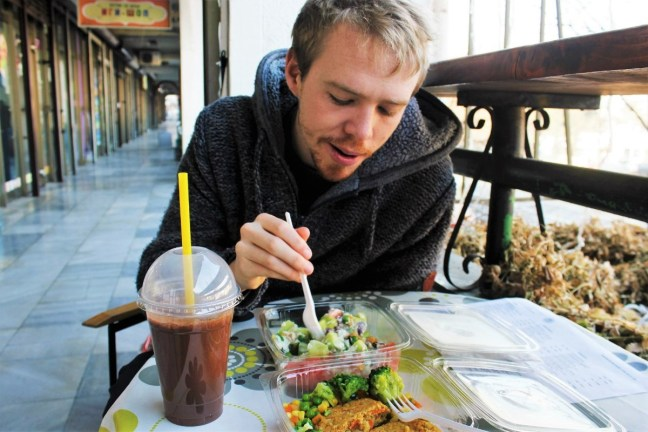 Vegan in Skopje Macedonia - Luke eating at raw food cafe - Charlie on Travel