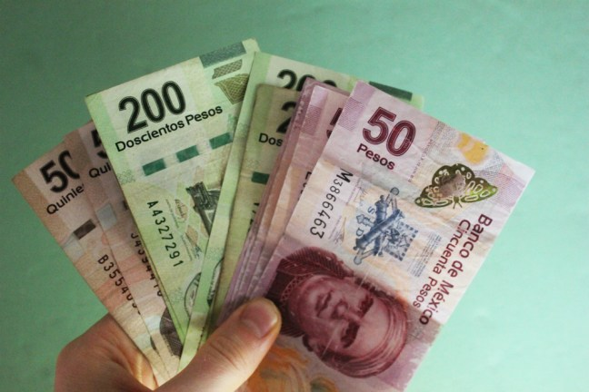 Mexican pesos - Mexico Travel Checklist - Charlie on Travel