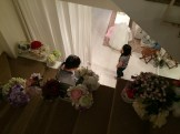 Coming down the stairs, surrounded by flowers