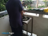 Dishes are washed in a sink outside the room