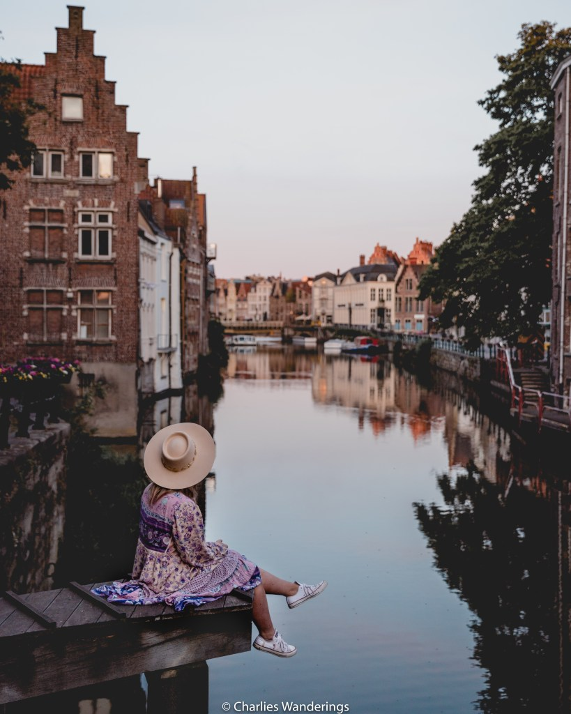 girl sitting by canal