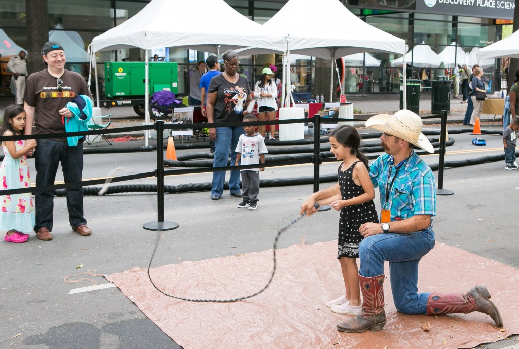 cracking a whip at Charlotte Mini Maker Faire