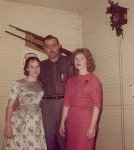 Me, Dad and Mom, a cuckoo clock and a couple of rifles.